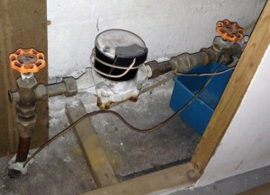 Inside main water shutoff and meter