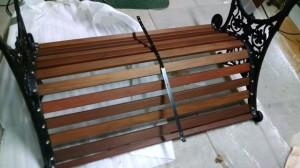 Aluminum strap screwed to backside of slats distributes the weight.
